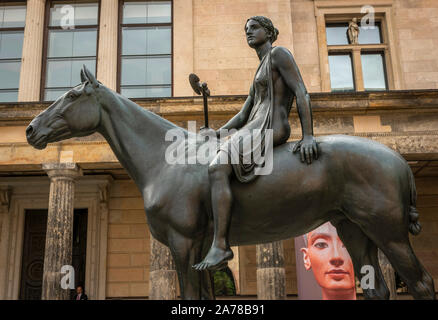 Amazon on horseback bronze sculpture by Louis Tuaillon outsie The Neues Museum, Berlin, Germany - Stock Photo