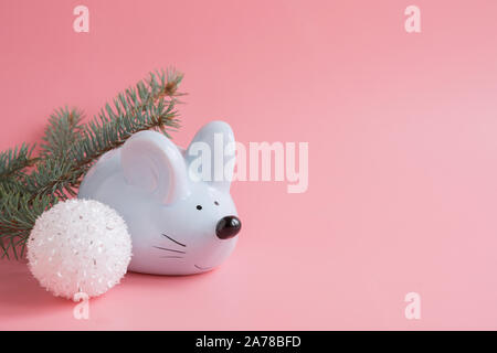 Chinese Zodiac Sign Year of Rat. Little rat as money box and white ball, branches on pink background. Symbol of 2020 with space for text. Happy New Ye - Stock Photo