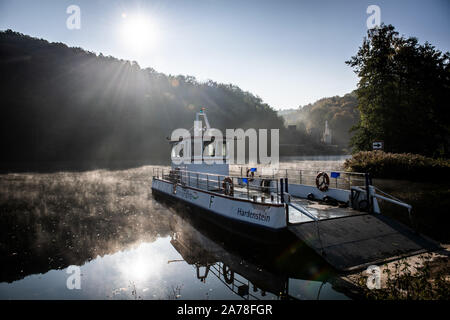 Witten, Germany. 31st Oct, 2019. The Ruhrtal ferry lies on the last day of the season in the sun at the jetty. In the background you can see the castle ruin Hardenstein. For a donation, the passenger ferry transports pedestrians and cyclists from one bank of the Ruhr to the other. From November to February there is no ferry service here. Credit: Bernd Thissen/dpa/Alamy Live News - Stock Photo