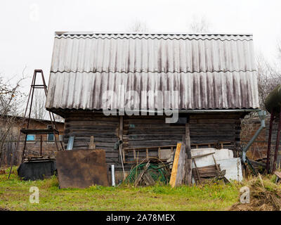 Old shed in the village of wooden beams and slate roof - Stock Photo