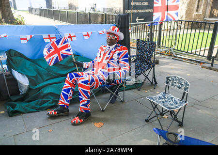 London UK. 31 October 2019.Pro-Brexit campaigner Joseph Afrane outside Parliament, on the day a Brexit deadline of 31 October when Britain was supposed to leave the European Union passes. amer ghazzal /Alamy live News - Stock Photo