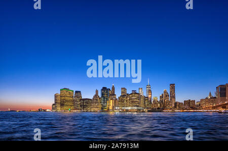 Sunset view of Manhattan island skyline in New York City shot from Brooklyn
