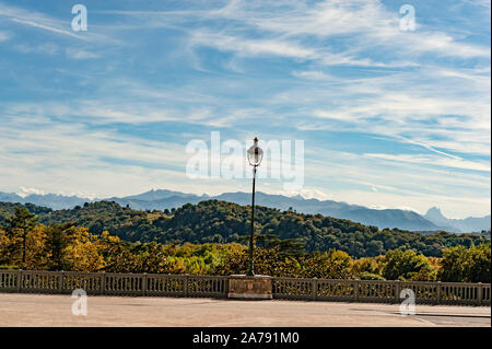 The french Pyrenees seen from the Boulevard des Pyrenees in Pau, Béarn, France - Stock Photo