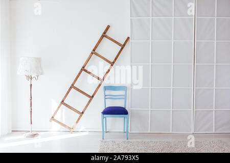 blue chair wooden staircase flooring in the interior of the white room - Stock Photo