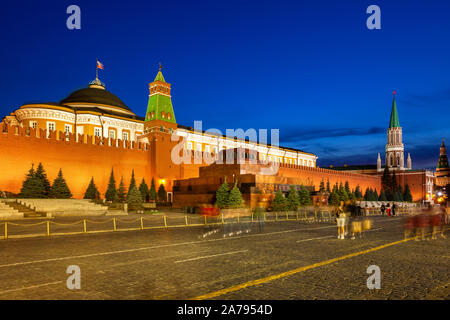 The view of the illuminated Lenin's Mausoleum and Kremlin Senate at dusk, Red Square, Moscow - Stock Photo