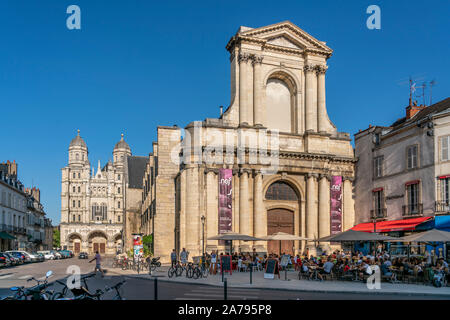 Cafe in front of the Nave of the Church of Sainte Bernadette, Central library, Place of Theatre, background Saint Michel church, Dijon, Burgundy, Fran - Stock Photo