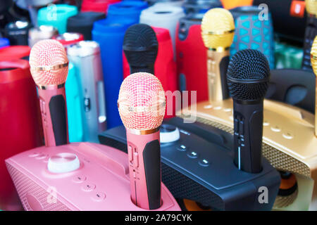 Microphone voice speaker on audio synthesiser electronic music instrument sound mixer machine in broadcasting studio room, seminar event or wedding - Stock Photo