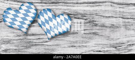 Oktoberfest hearts on wood background - Stock Photo