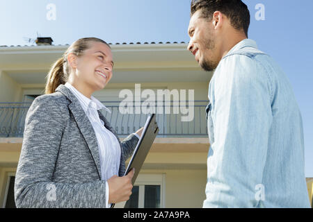 real estate agent shows new apartment in building - Stock Photo