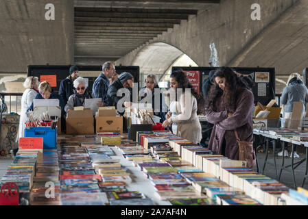 People browsing the stalls at the Southbank Centre book market, London, England, UK - Stock Photo
