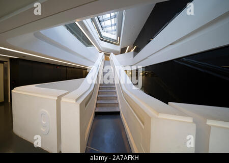 Interior of modern architecture of PolyU School of Design Jockey Club Innovation Tower at Hong Kong Polytechnic University, Hong Kong. Architect Zaha - Stock Photo