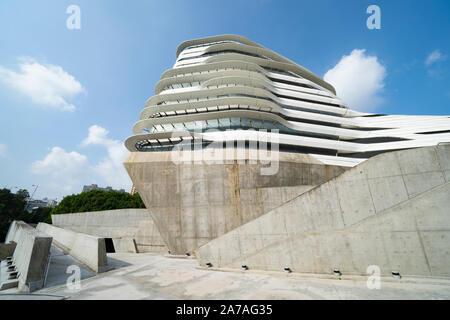 Exterior of modern architecture of PolyU School of Design Jockey Club Innovation Tower at Hong Kong Polytechnic University, Hong Kong. Architect Zaha - Stock Photo