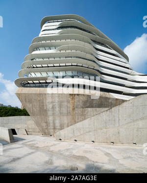 Exterior of modern architecture of PolyU School of Design Jockey Club Innovation Tower at Hong Kong Polytechnic University, Hong Kong. Architect Zaha - Stock Photo