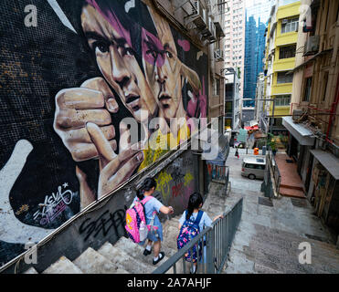 Street art of Bruce Lee by Xeva on  wall at Tank Lane in Sheung Wan Hong Kong, China - Stock Photo