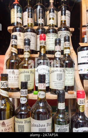 Bottles of aged Calvados Brandy in shop window, Place de Catherine, Honfleur, Normandy, France - Stock Photo