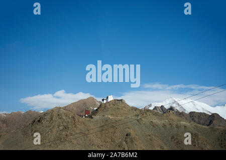 View landscape of  Thiksey monastery and Namgyal Tsemo Gompa from Khardung La Road in Himalaya mountain between go Nubra valley and Pangong lake in Ja - Stock Photo