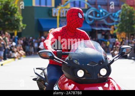 Spider-Man Marvel Character, Superhero makes appearance on Motorbike at Super Hero Island, Islands of Adventure, Universal Studios Resort, Orlando - Stock Photo
