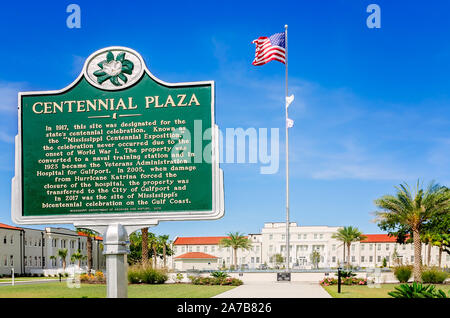 An American flag flies at the Centennial Plaza fountain, Oct. 22, 2019, in Gulfport, Mississippi. - Stock Photo