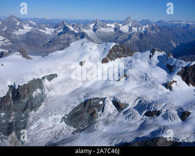 ITALIAN SIDE OF 4164m-HIGH BREITHORN, 4506m-HIGH WEISSHORN IN THE DISTANCE (aerial view). Aosta Valley, Italy & Canton of Valais, Switzerland. - Stock Photo