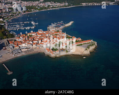 MEDIEVAL TOWN ON A ROCKY PROMONTORY (aerial view). Budva, Montenegro. - Stock Photo