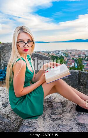 Bookworm nerdy teen blond blonde fairhair fair-hair haired with optical glasses spectacles - Stock Photo