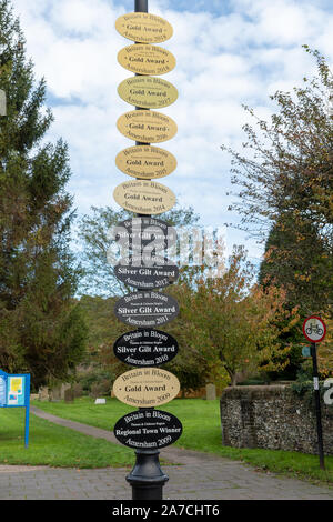 Britain in Bloom awards or plaques in Amersham Old Town displayed up a lamppost, Buckinghamshire, UK - Stock Photo