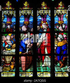 Stained Glass in the Church of St James in Le Treport, France, depicting Jesus and Mary at the Marriage at Cana - Stock Photo