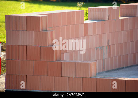 hollow clay blocks wall, detail view of hollow brick wall unter construction - Stock Photo