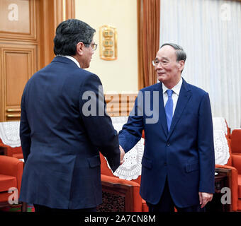 Beijing, China. 1st Nov, 2019. Chinese Vice President Wang Qishan (R) meets with visiting Ecuadorian Foreign Minister Jose Valencia in Beijing, capital of China, Nov. 1, 2019. Credit: Zhang Ling/Xinhua/Alamy Live News - Stock Photo