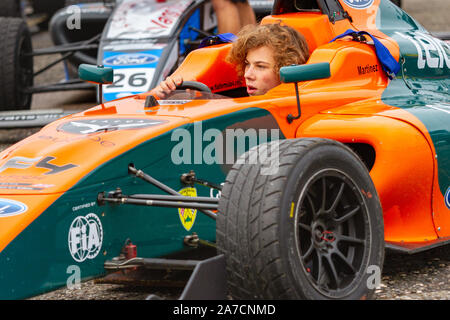 Mariano Martinez drives from the paddock after Saturday qualifying. British Formula 4. Last race weekend of the season. Brands Hatch, 12 Oct 2019 - Stock Photo