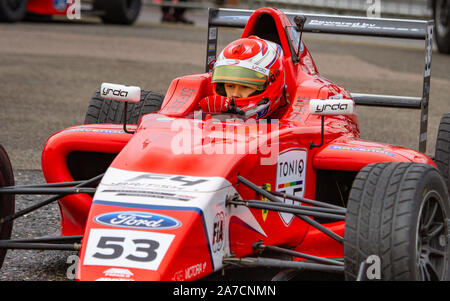 Tommy Foster drives back to garage from paddock after Saturday Qualifying. British Formula 4. Last race weekend of season. Brands Hatch Oct 12 2019 - Stock Photo