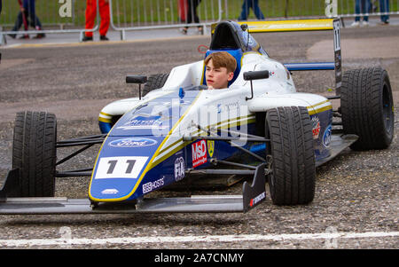 Luke Browning drives from paddock to garage after Saturday Qualifying. British Formula 4. Last race weekend of the season. Brands Hatch, 12 Oct 2019 - Stock Photo