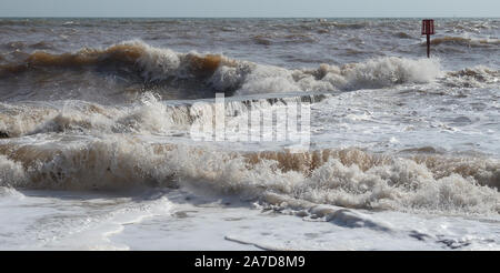 Waves crashing over a breakwater at Dawlish during high tide. - Stock Photo