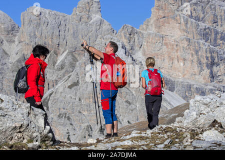 Tourists taking pictures of mountain scenery in the Sexten Dolomites / Dolomiti di Sesto / Sextener Dolomiten, nature reserve in South Tyrol, Italy - Stock Photo