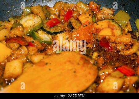 Ratatouille is a French Provencal stewed vegetable dish, originating in Nice. Recipe ingredients include tomato, garlic, onion, zucchini, aubergine (e - Stock Photo
