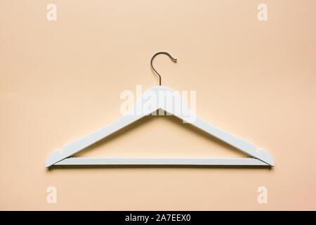 white wooden shoulder on pastel orange background. Fashion feminine blog sale store promo design shopping concept. Flat lay, top view, mockup - Stock Photo