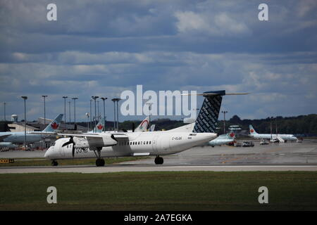 De Havilland Dash 8 C-GLQG Porter Airlines taxiing at YUL Montreal International Airport, Quebec, Canada, August 23, 2019 - Stock Photo