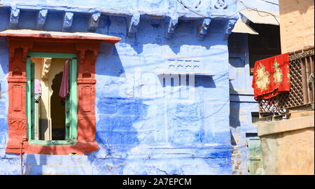 Stunning view of a colorful window of a house among the narrow streets of the blue city of Jodhpur, Rajasthan.