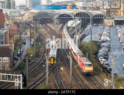Northen Rail Sprinter and InterCity 225 LNER Trains crossing the complex junction at the eastern end of Newcastle Central station, England, UK - Stock Photo