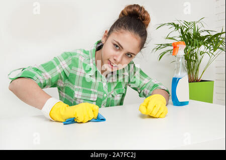 Gloved housewife cleans the apartment - Stock Photo