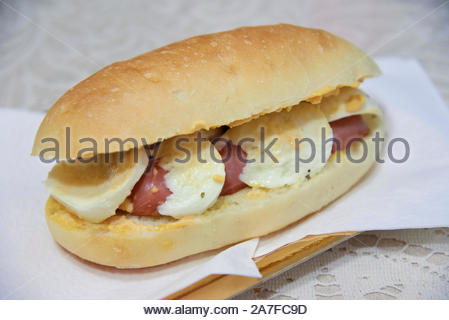 Hot dod sandwich with mozzarella and sausage - Stock Photo