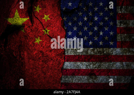 Composite image of US flag and China flag on the cracked rocky wall as a trade conflict concept