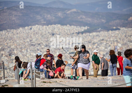 Athens capital of Greece view from landmark ruins Parthenon Temple Athens Acropolis, Situated on top of a rocky hill, overlooking the city of Athens
