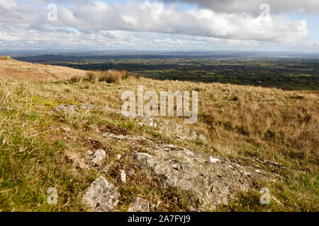 autumn view from Slieve Gallion over County Derry and county antrim Northern Ireland with rock poking through in the foreground - Stock Photo