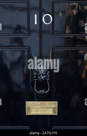 London, UK. 28th Oct, 2019. A view of the door at No 10 Downing Street in London.No Number 10, is (along with the adjoining Cabinet Office at 70 Whitehall) the headquarters of the Government of the United Kingdom and the official residence and office of the First Lord of the Treasury, a post which, for much of the 18th and 19th centuries and invariably since 1905, has been held by the Prime Minister of the United Kingdom. The UK's next general election will be on 12 December 2019 and the incoming British Prime Minister will enter No 10 Downing Street soon after the overall resul - Stock Photo