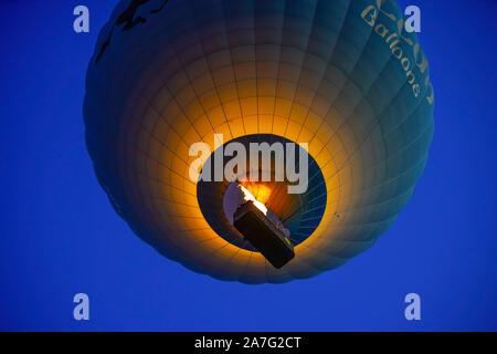 Hot Air Balloon Flying Over Amazing Rock Landscape At Cappadocia, Anatolia, Turkey. - Stock Photo