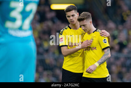 Dortmund, Germany. 02nd Nov, 2019. Soccer: Bundesliga, Borussia Dortmund - VfL Wolfsburg, 10th matchday at Signal Iduna Park. Dortmund's Marco Reus is comforted by Julian Weigl during his substitution. Credit: Bernd Thissen/dpa - IMPORTANT NOTE: In accordance with the requirements of the DFL Deutsche Fußball Liga or the DFB Deutscher Fußball-Bund, it is prohibited to use or have used photographs taken in the stadium and/or the match in the form of sequence images and/or video-like photo sequences./dpa/Alamy Live News - Stock Photo