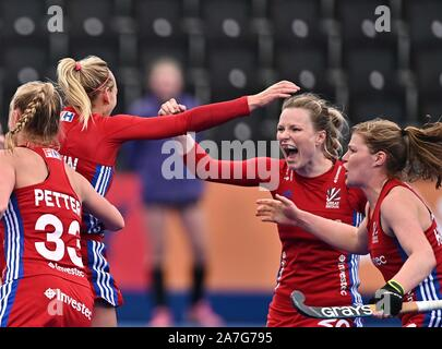Stratford. United Kingdom. 02 November 2019. The Great Britain players celebrate their second goal. Izzy Petter (Great Britain, 33), Hollie Pearne-Webb (Great Britain, captain, 20) and Tess Howard (Great Britain). Great Britain v Chile. FIH Womens Olympic hockey qualifier. Lee Valley hockey and tennis centre. Stratford. London. United Kingdom. Credit Garry Bowden/Sport in Pictures. Credit: Sport In Pictures/Alamy Live News - Stock Photo