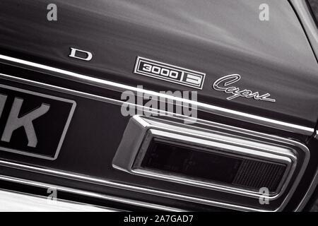 Right rear quarter detail of a sunburst 1970's Ford Capri 3000E showing badge and rear light cluster. - Stock Photo