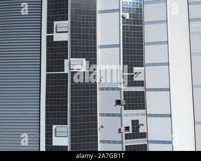 Solar panels on the roof of a factory for producing of green ecological electricity. Drone view - Stock Photo
